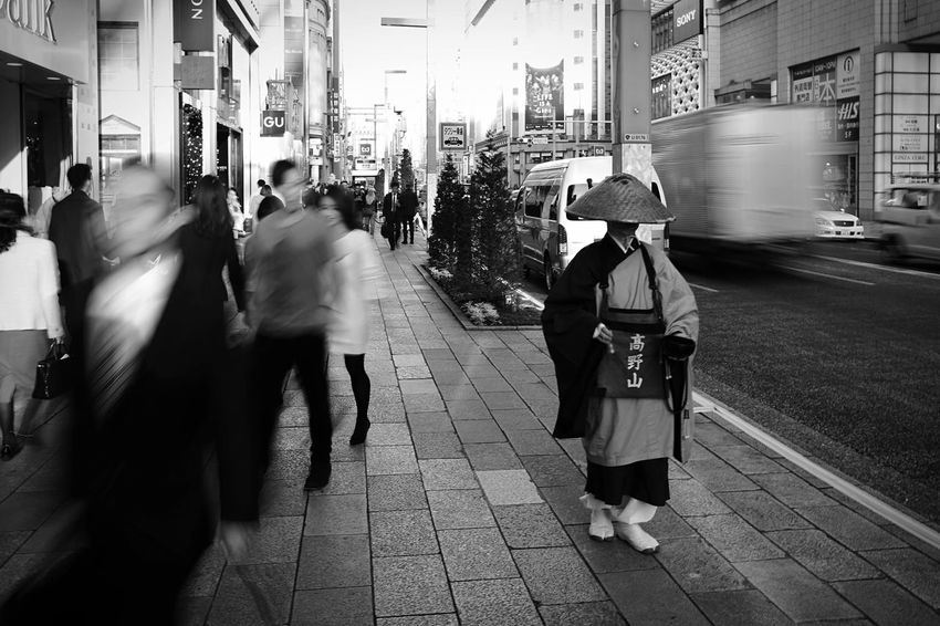 Monk  Streetphotography Street Standing Still Life Blackandwhite Black And White Contrast Zen Japan Japan Photography Ginza Long Exposure Blur People People Watching Walking Metropolis Metropolitan Chance Encounters