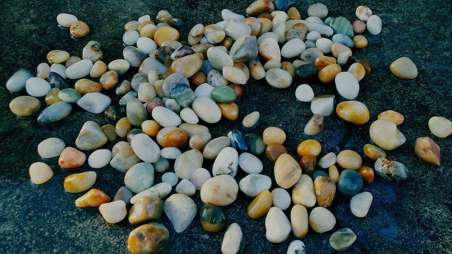High angle view of pebbles on pebble beach