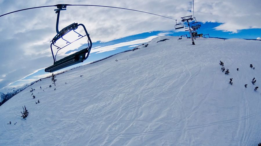EyeEm Gallery EyeEm Best Shots Winter Snow Cold Temperature Weather Nature Ski Lift Ski Holiday Sky Day Non-urban Scene Skiing Beauty In Nature Scenics Cloud - Sky Overhead Cable Car Leisure Activity White Color Outdoors Tranquility Frozen Shades Of Winter