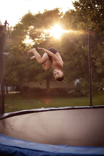 Boy flipping on