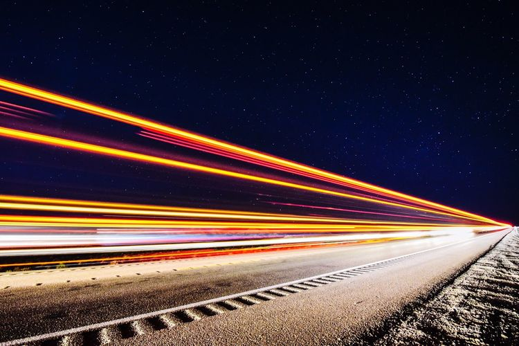 Lights from a truck as it drives down the highway. Speed Transportation Light Trail Long Exposure Motion Night Road High Street Blurred Motion No People Illuminated Outdoors Clear Sky Sky Let's Go. Together.