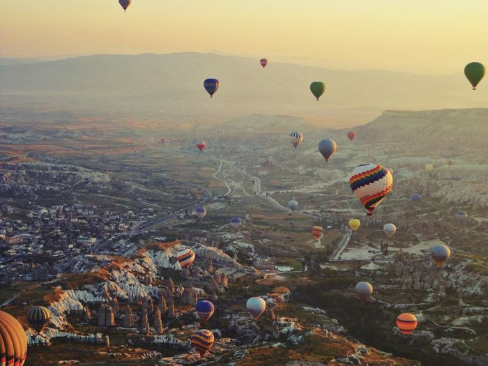 Hot Air Balloons Flying Over Cappadocia During Sunrise