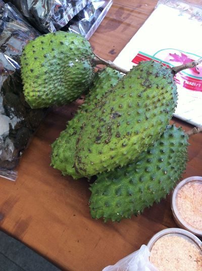 Soursop, Prickly Custard Apple (Annona muricata L.) ทุเรียนเทศ from southern province of Thailand Day Food Food And Drink Freshness Fruits Green Color Guanabana Guyabano Healthy Eating High Angle View Indoors  Market Place Market Stall No People Rare Ready-to-eat Table Tropical