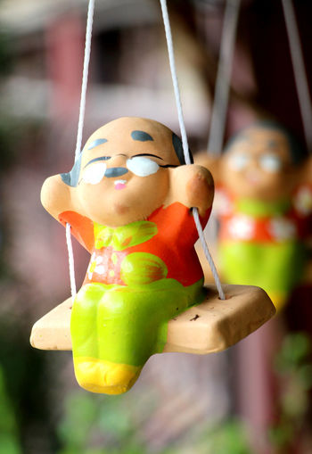 Hanging Doll Close-up No People Indoors  Water Day Freshness Old Toy Clay Clay Doll Colorful Color Ceramic Ceramic Doll Swing Baked Clay Happy Happiness Relax Health Simple Backgrounds Freshness