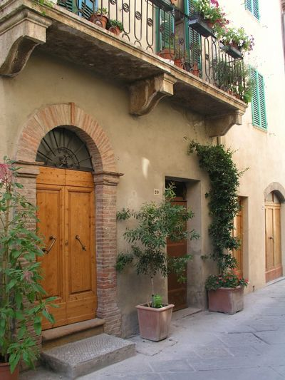 Pienza Tuscany Italy Architecture Potted Plant Plant Built Structure Building Exterior No People Outdoors Doorways Balcony Wrought Iron Railings Granite Step