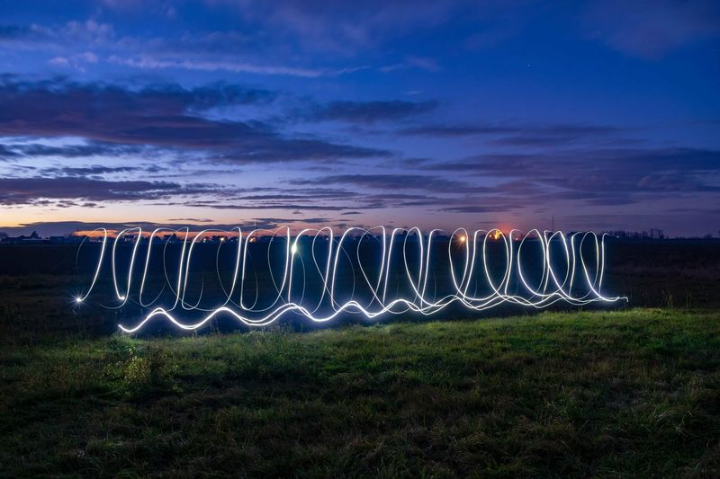 Drawing in the air Sky Dusk Colours Dusk EyeEmNewHere Capture Tomorrow Illuminated Grass Light Painting Repetition Light Trail Entertainment Glowing Long Exposure