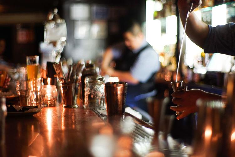 Bartender Alcohol Bar - Drink Establishment Bar Counter Drink Food And Drink Glass Indoors  Nightlife Refreshment Selective Focus