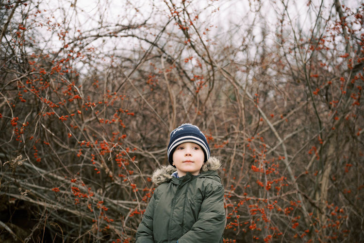 Portrait of boy standing in snow