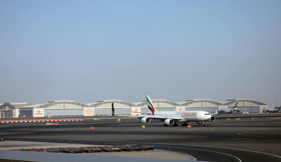 Emirates Airbus A340 at Dubai Airport on December 09, 2012 in Dubai, UAE. Emirates handles major part of passenger traffic and aircraft movements at the airport. A340 Airbus Aircraft Airfield Airline Airliner Airplane Airport Aviation Carrier Dubai Emirates Flight Fuselage Jet Journey Load Plane Runway Terminal Traffic Transportation Travel Wings