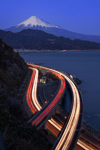 High angle view of light trails on road against sky