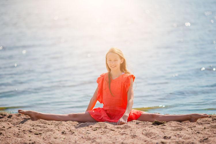 Portrait of woman sitting on beach