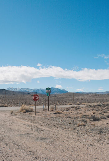 Arid Climate Arid Landscape Blue Cloud - Sky Communication Day Death Valley Death Valley National Park Desert Desert Landscape Mountains Nature Nature Outdoors Road Road Sign Roadtrip Sky Speed Limit Sign Sunlight Text Tranquil Scene Tranquility Transportation