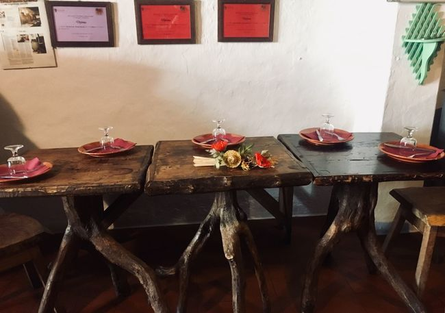 Old taverna at south of Portugal Wooden Table Old Restaurant Tavern  Portugal Table No People Indoors  Bowl Nature Food And Drink Flower Container Glass Seat