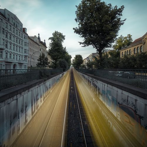 Yellow Transportation Perspective Subway Train Metro Bvg Berlin Schönhauser Allee Longexposure Tree Plant Transportation Sky Diminishing Perspective The Way Forward Nature Architecture Direction Building Exterior Built Structure Road City No People Day Outdoors Street Railing Cloud - Sky