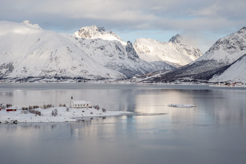 Sildpollnes church Lofoten Islands Norway Winter Beauty In Nature Cloud - Sky Cold Temperature Fjord Lofoten Mountain Mountain Range No People North Outdoors Reflection Scenics - Nature Sea Sky Snow Snowcapped Mountain Tranquil Scene Tranquility Water Winter