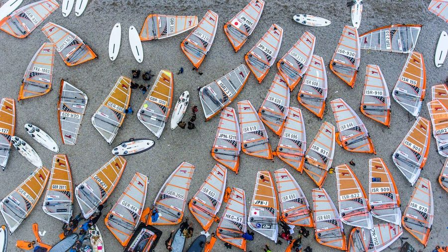 Windsurfing championship Windsurfing Sails International Competition Championship Sailing Garda Lake Torbole Beach Above View High Angle View Large Group Of Objects Boards Event Many Same  Similar Equipment Gear Sport Sports Youth Italy Lying Down