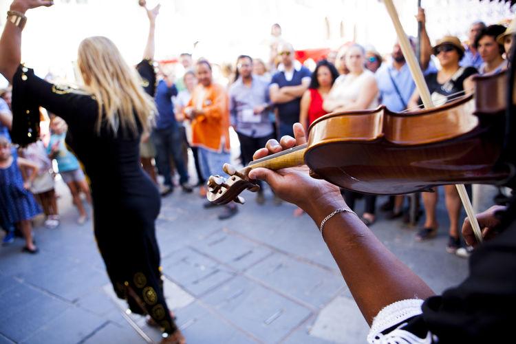Street Performer Performing In City Street