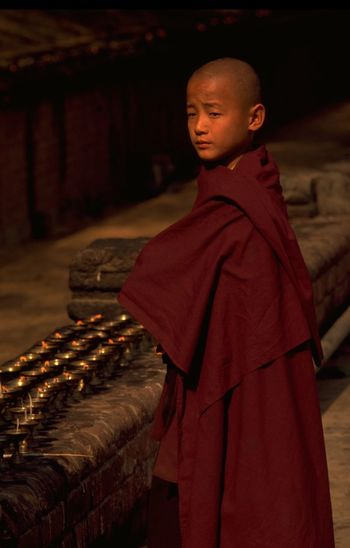 Young novice monk in maroon robe meditates beside candles in the afternoon sun at Mahabodhi Temple, India. Bodh Gaya's Mahabodhi Temple gained its UNESCO World Heritage Listing in 2002. A religious site and place of pilgrimage, Bodh Gaya (in Bihar State) is where Gautama Buddha is said to have obtained enlightenment; after meditating under the Bodhi tree, for 49 days. For Buddhists, Bodh Gaya is the most important of the main four pilgrimage sites related to the life of Gautama Buddha; something akin to Mecca for Muslims. Bodh Gaya is about 12km from Gaya City, where overnight trains connect with Kolkata (Calcutta). The best time to visit is November to March; with December and January considered the high season. http://pics.travelnotes.org Afternoon Sun Alternative Fitness ASIA Bodh Gaya Boy Buddhism Candles Culture Faith Focus Object Golden Hour India Snap a Stranger Maroon Robe Meditation Michel Guntern Monk  Portrait Religion Selective Focus Travel Travel Photography Travel Photos Travel Pics People And Places Neighborhood Map