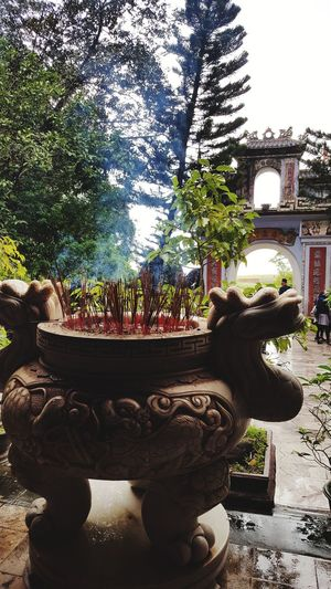 Travel Destinations Travel Photography Tranquility Vietnam Temple Encens Voyage Outside Photography Art And Craft No People Day Statue Sculpture Outdoors Tree Nature Architecture Close-up Sky Built Structure