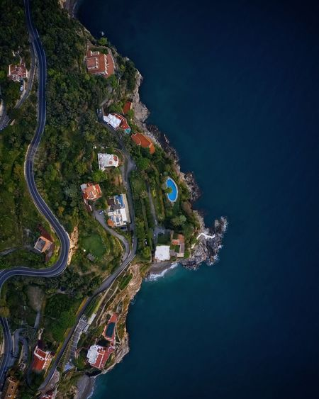 Coastline from high above, shot by drone Pool Amalfi Coast Amalfi  Aerial View Aerial Photography Landscape Italian Riviera Seaside Ocean Mountains And Sky Windy Road Road Mountain Road Steep Slope Slope Terraced Houses Tree City Mountain Beauty Blue Clear Sky Water Aerial View Sky Coast Housing Settlement Residential Structure Exterior Rooftop