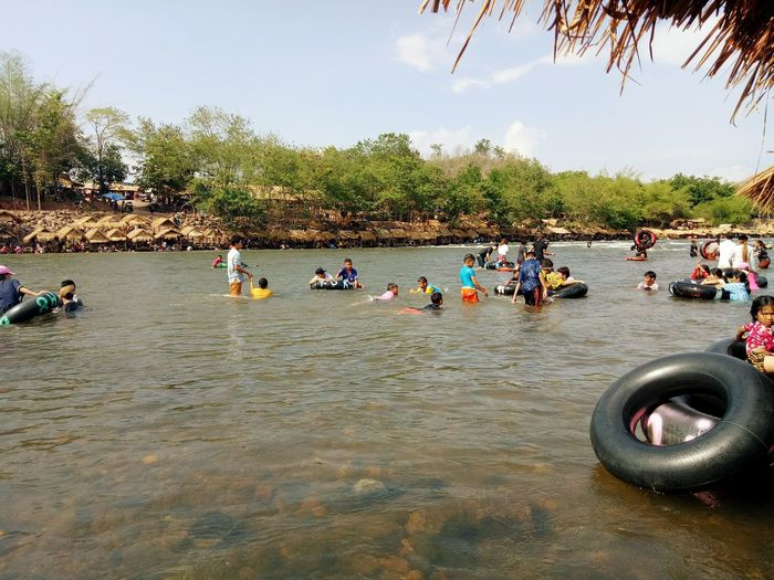 Water play Leisure Activity Large Group Of People Water River Beach Day Tree Women Outdoors People Men Adult Adults Only Sky Real People Only Women Coordination Nature