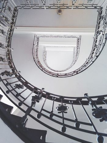 Overhead View Indoors  Steps And Staircases Railing Built Structure Architecture Staircase Spiral Staircase Low Angle View Steps Design Spiral Directly Below Spiral Stairs Repetition Hand Rail Stairs Steps And Staircase Coil Circle No People Bright Inside Indoor Old House