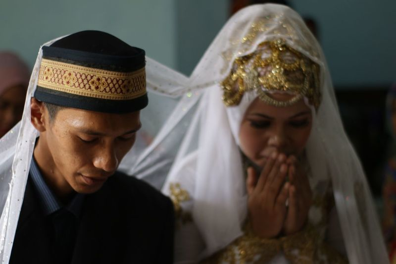 Close-up of bridegroom during wedding ceremony