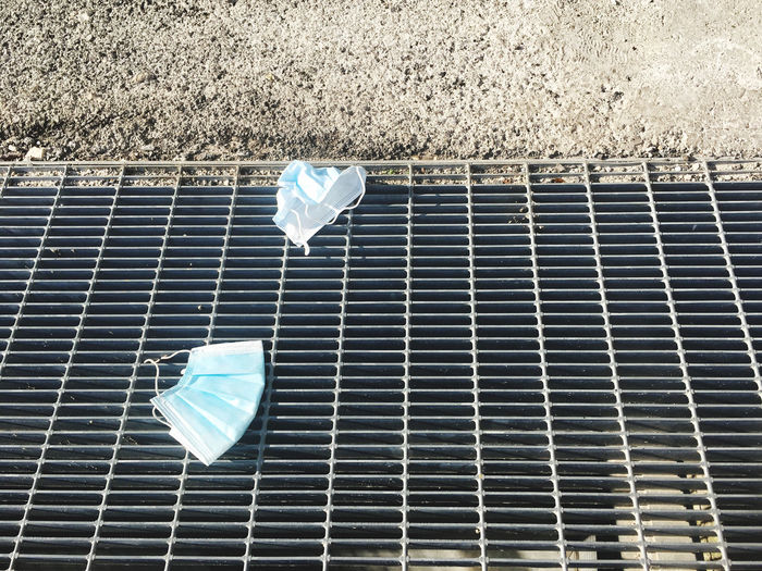 High angle view of surgical mask on road
