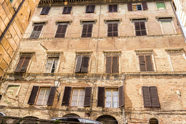 Shot in the city of Siena, Italy Abandoned Architecture Building Building Exterior Built Structure City Day Full Frame History In A Row Low Angle View Nature No People Old Outdoors Residential District Run-down Sunlight The Past Window
