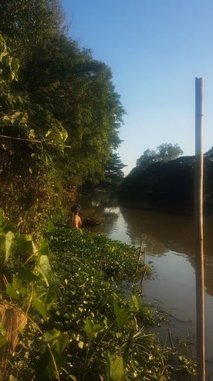 Another day in Paradise Tree Reflection Water Nature Outdoors Beauty In Nature River Riverside Following Following The Path Fisherman Fishermen Fishing Boat One Man Only Asian Cultures Daytime Nature Nature Photography Old Ways Living Life