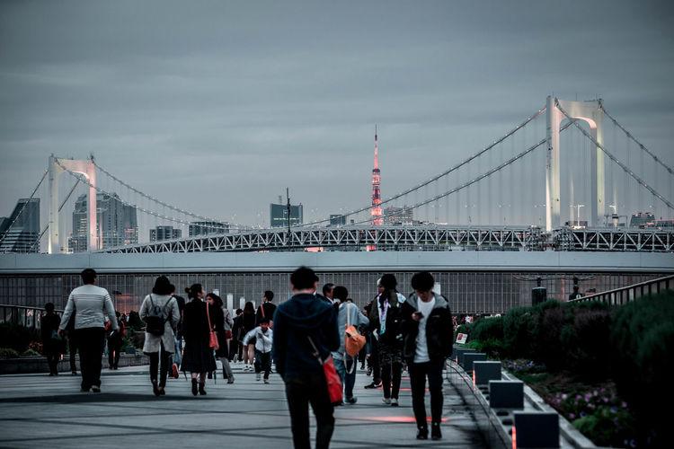 Group of people on suspension bridge