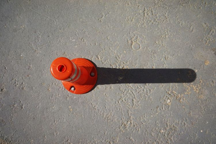 Bollard Red No People Day High Angle View City Nature Outdoors Sunlight Close-up Orange Color Security Street Road Safety Shadow