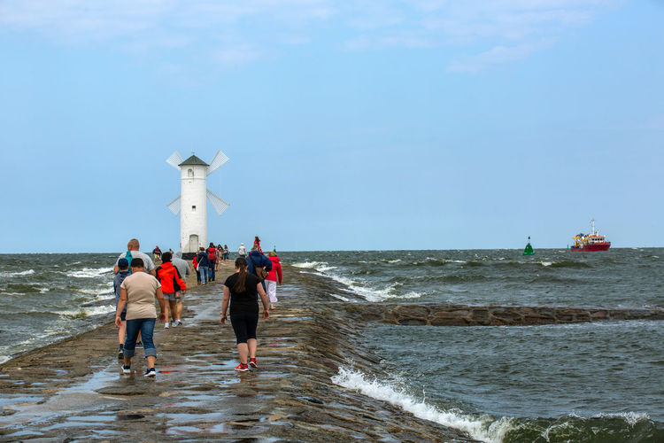 Baltic Baltic Sea Stawa Młyny Beach Beauty In Nature Day Full Length Group Of People Horizon Horizon Over Water Land Leisure Activity Lifestyles Motion Nature Outdoors People Real People Scenics - Nature Sea Sky Water Women