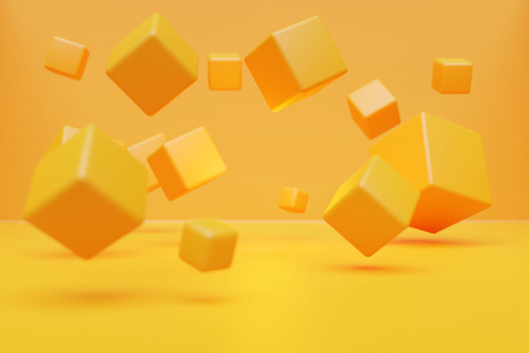Close-up of yellow objects over white background