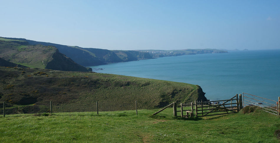 Beauty In Nature Blue Clear Sky Coast Coastline Landscape Cornwall Day Fences Gate Grass Green Color Landscape Nature No People Outdoors Scenics Sea Sky Tranquil Scene Tranquility Water