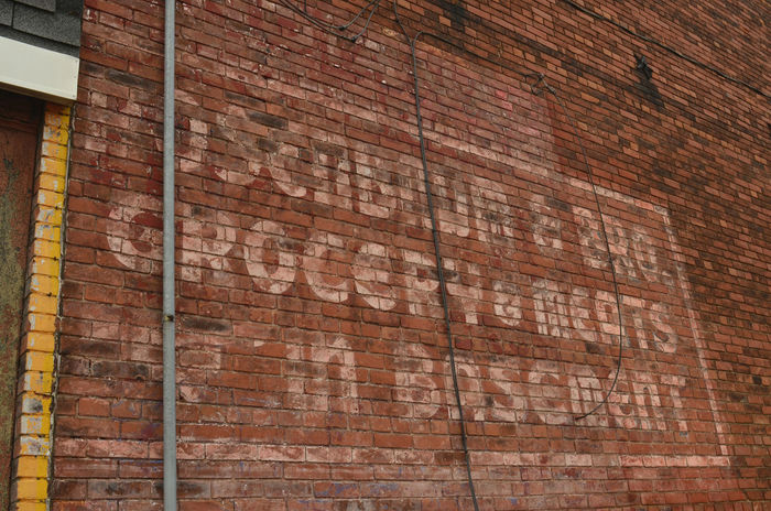 "faded vintage painted sign on old brick building often called ""ghost signs"" Ghost Sign Ghost Signs  Signs Text Vintage Style Vintage Sign Vintage Signs Architecture Brick Wall Building Exterior Built Structure Close-up Day Lettering No People Outdoors Retro Design"