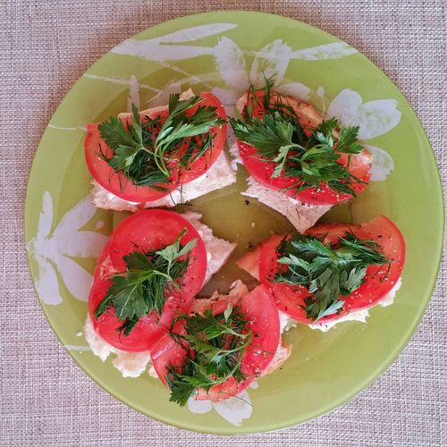 Bread with tomatoes and herbs. Bread Tomatoes Plate Healthy Food Herbs