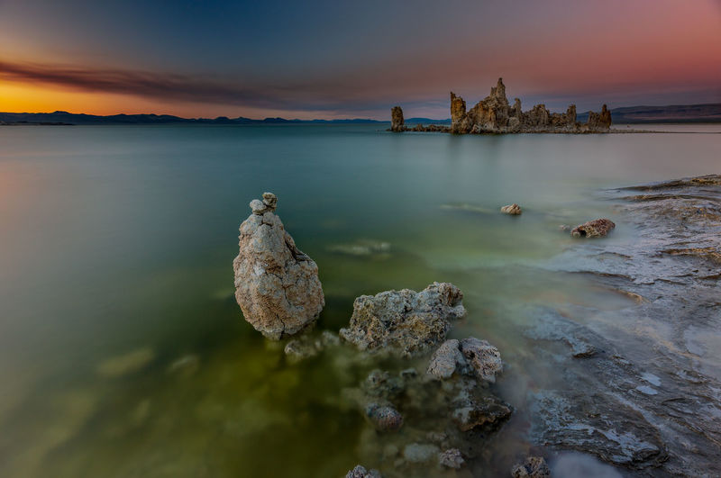 The sky was burning Battleship at Mono Lake stood its ground as the sky was still burning and the smoke snaked across over the lake. Beauty In Nature California Cloud Cloud - Sky Fire Idyllic Lake Lanscape Photography Nature No People Orange Color Outdoors Remote Rock Rock - Object Rock Formation Salt Scenics Sky Smoke South Tufa Sunset Tranquility Water