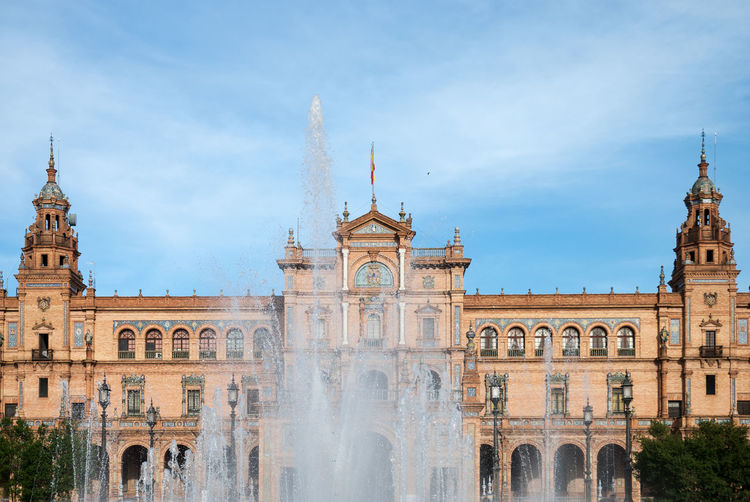 Plaza de espana with fountain in Sevilla Andalucía Andalusia Architecture Blue Sky Building Building Exterior City Day España EyeEmNewHere Fountain Old Place Plaza Plaza De España Sevilla Seville Sky SPAIN Travel Destinations Water