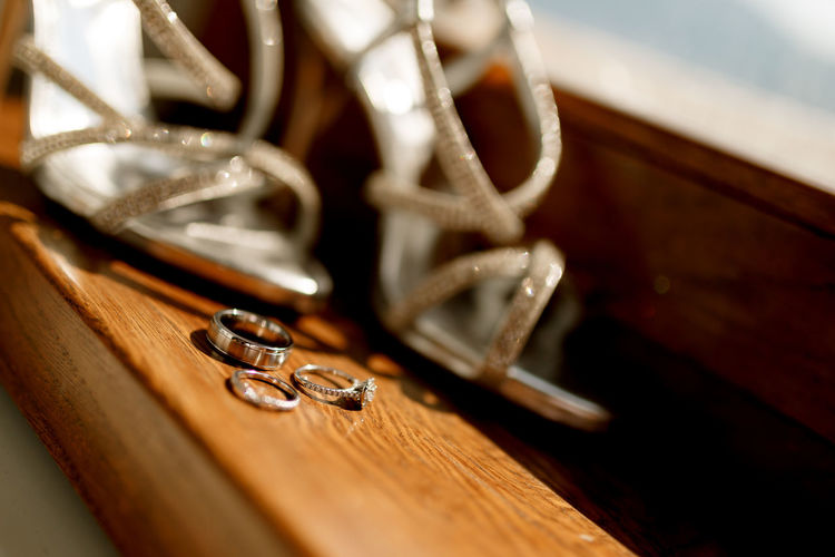 High angle view of wedding rings on table
