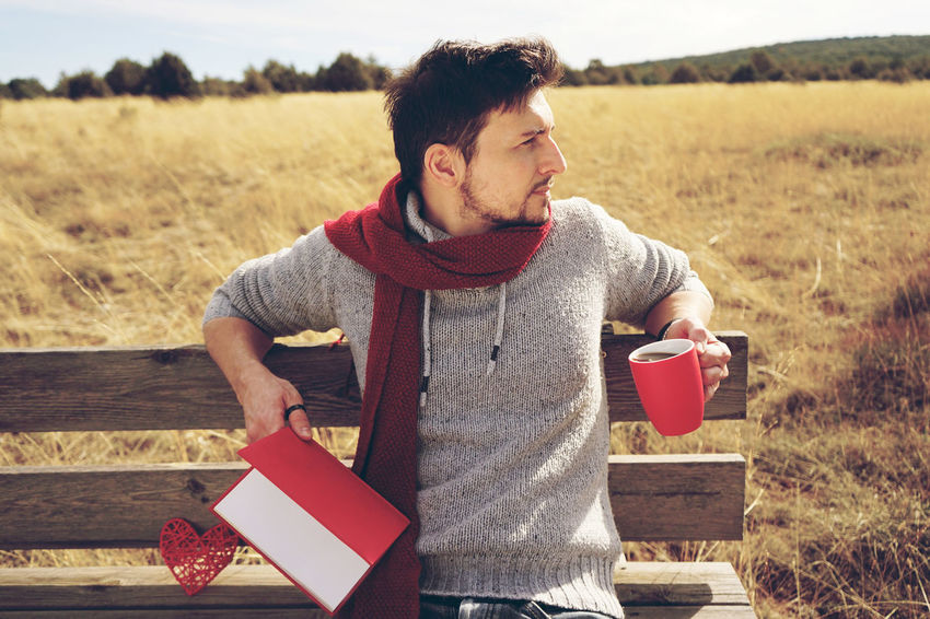 Coffee One Person Land Front View Field Holding Real People Day Nature Casual Clothing Young Men Men Food And Drink Lifestyles Rural Scene Landscape Young Adult Plant Drink Outdoors