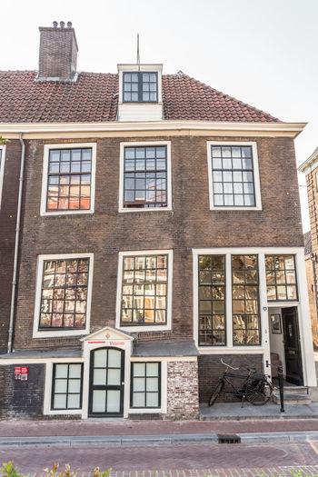 Amsterdam Netherlands Architecture Brick Building Building Exterior Built Structure City Clear Sky Crooked House Day Dutch Houses Education Façade Glass - Material Holland House Leaning Low Angle View Nature No People Outdoors Residential District Row House Sky Subsidence Wall Window
