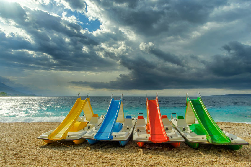Summer moved on // Coastline Copy Space In A Row Travel Adriatic Sea Beach Cloud - Sky Day Horizon Over Water Multi Colored Nautical Vessel No People Outdoors Pedal Boat Scenics Sea Season  Shore Summer Sunlight Tourism Tranquil Scene Tranquility Vacations Water