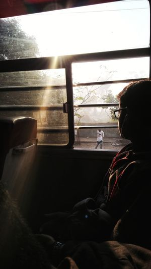 Rear view of woman sitting in bus