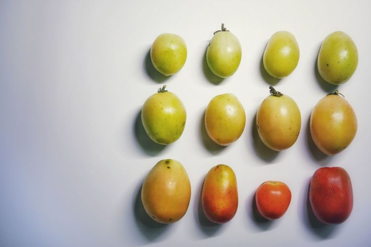 Close-up of fruits in basket on white background