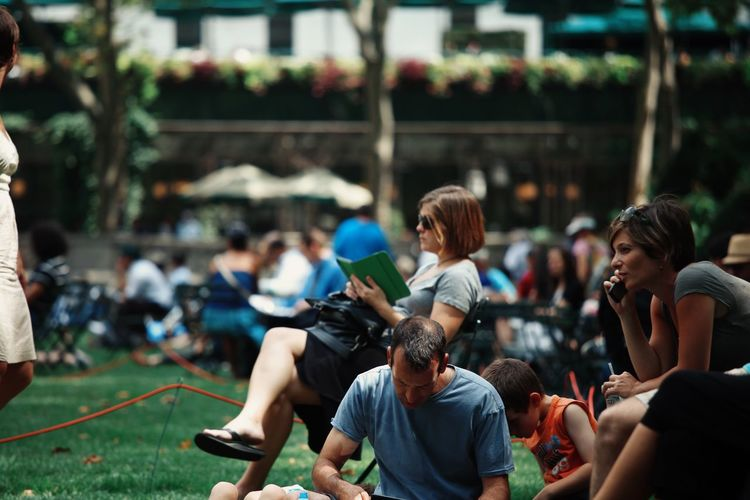 Everyday Joy Park People Summer Streetphotography Close Up Group Of People New York New York City Bryant Park NYC Bryant Park  Open Edit Reading Sun Children Still Life Street Photography People Watching