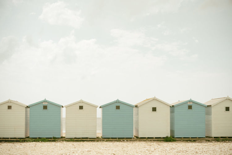 Beach huts against sky