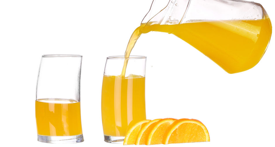 Yellow drink against white background