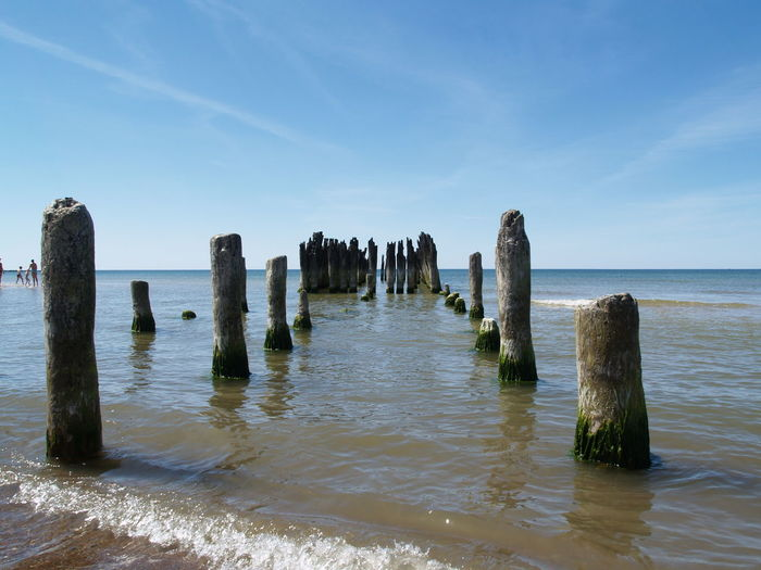 Woodden piles left from old pier in the Baltic sea. Beauty In Nature Day Horizon Over Water Nature No People Old Pier Posts Outdoors Scenics Sea Sky Tranquil Scene Tranquility Water Waterfront Woodden Woodden Piles Wooden Post