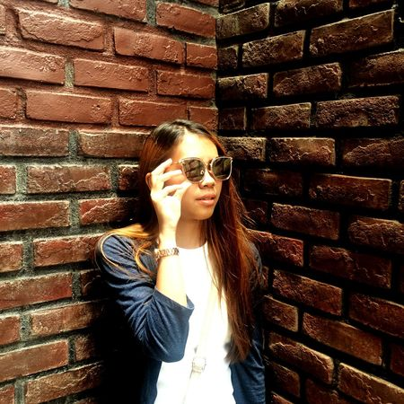 Only Women Brick Wall One Woman Only Adult One Person Adults Only Mid Adult People Standing Front View Outdoors Day Eyeglasses  Women Lifestyles Young Adult One Young Woman Only Beauty Beautiful Woman Portrait Filipina Beauty Filipina Friendship